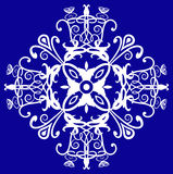 Edwardian design. Floral filigree and spiral pattern in white against a royal blue background, use as a logo, symbol, motif, postcard, label, clip art, tile or Royalty Free Stock Photo