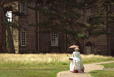 Edwardian Lady In Front Of Stately Home. Lady In Edwardian Period Costume In Front Of Stately Home royalty free stock image