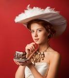 Edwardian women with cake Royalty Free Stock Photo
