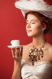Edwardian women with cup Royalty Free Stock Photos
