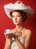 Edwardian women with cup Stock Photography