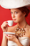 Edwardian women with cup Royalty Free Stock Images