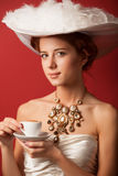 Edwardian women with cup Stock Images