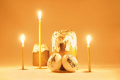 Eeaster orthodoxy christianity tradition. Still-life with candles, eggs and cakes in Russian style Stock Image