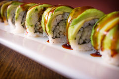 Eel Avacado Dragon Roll. With sushi bbq sauce Stock Photos