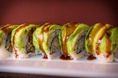 Eel Avacado Dragon Roll. With sushi bbq sauce Royalty Free Stock Photos