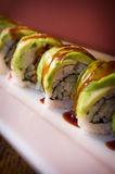 Eel Avacado Dragon Roll. With sushi bbq sauce Royalty Free Stock Photography