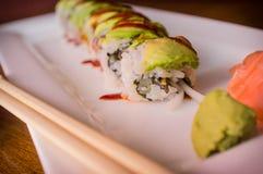 Eel Avacado Dragon Roll. With sushi bbq sauce Royalty Free Stock Photo