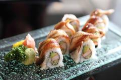 Eel and avocado maki sushi, Japanese food. Eel and avocado maki sushi on a plate royalty free stock photos