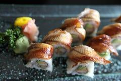 Eel and avocado maki sushi, Japanese food. Eel and avocado maki sushi on a plate stock images