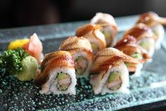 Eel and avocado maki sushi, Japanese food. Eel and avocado maki sushi in close up stock images