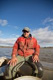 Eel Fisherman. Portrait of professional Eel Fisherman on board his aluminium dinghy royalty free stock image