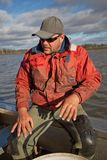 Eel Fisherman. Portrait of professional Eel Fisherman on board his aluminium dinghy royalty free stock photo