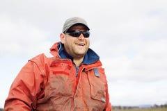 Eel Fisherman. Portrait of professional Eel Fisherman on board his aluminium dinghy royalty free stock photography