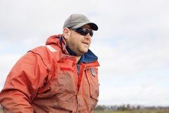 Eel Fisherman. Portrait of professional Eel Fisherman on board his aluminium dinghy royalty free stock images