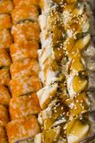 Eel and philadelphia rolls with yellow caviar. Packed Stock Image