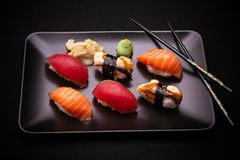 Eel, salmon and tuna sushi with chopsticks Stock Photography