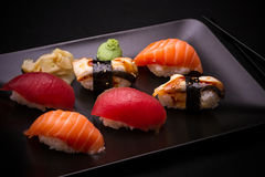 Eel, salmon and tuna sushi with chopsticks Royalty Free Stock Photos