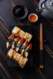 Eel Sushi Set nigiri and rolls. Served on black background Royalty Free Stock Image