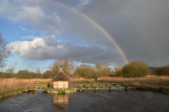 Eel Traps on the River Test Hampshire UK. Eel traps on the river Test on a showery day showing a double rainbow Royalty Free Stock Photography
