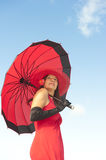 Eelegant woman red dress and gloves outdoor Royalty Free Stock Images