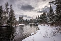 Creek in winter with cloudy sky stock photo