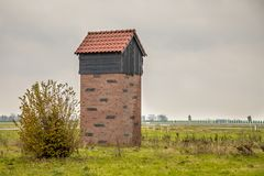 Bat house tower. EEMSHAVEN,NETHERLANDS - NOVEMBER 22, 2017: Bat house tower for protection and housing of pipistrelle bats in the Netherlands Stock Photo