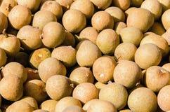 Een aantal Longan in fruitmarkt Stock Foto