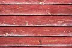 Een aantal planken met gebarsten rode verf Royalty-vrije Stock Afbeeldingen