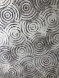 een aardig cirkel abstract kunstwerk op muur Stock Fotografie