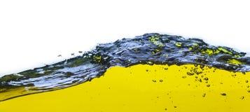 Een abstract beeld van gemorste olie Op een witte achtergrond Stock Afbeeldingen