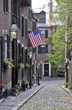 Een Amerikaanse die vlag op Eikelstraat wordt getoond in Boston, Massachusetts Stock Foto
