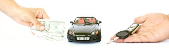 Een auto, een geld en een sleutel Stock Afbeelding