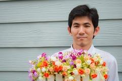 Een Aziatische bloem van de mensengreep stock afbeelding
