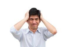 Een Aziatische mens houdt zijn hade als hoofdpijn Royalty-vrije Stock Fotografie