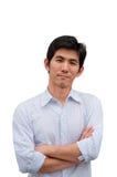 Een Aziatische mens kruist zijn wapen stock fotografie