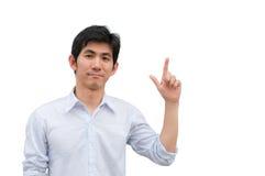 Een Aziatische mens richt zijn hand als huidig product royalty-vrije stock afbeelding