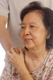 Een Aziatische oude vrouw Stock Foto