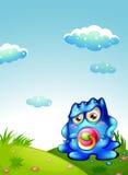 Een baby blauw monster bij de heuveltop Stock Afbeeldingen