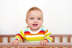 Een baby glimlacht Stock Foto's