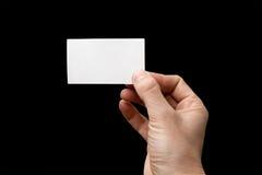 Een be*zoeken-kaart is in een hand Stock Fotografie
