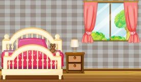 Een bed en een lamp Royalty-vrije Stock Foto