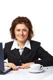 Een bedrijfsvrouw op het haar werk Stock Foto's
