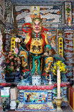 Een beeldhouwwerk van een demon in Boeddhistische mythologie stock afbeelding