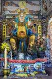 Een beeldhouwwerk van een demon in Boeddhistische mythologie royalty-vrije stock afbeelding