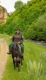 Een bejaarde bergbewoner op horseback Stock Afbeeldingen