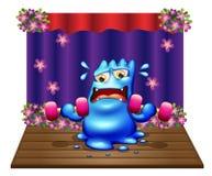 Een blauw monster die in het midden van het stadium uitoefenen Royalty-vrije Stock Foto