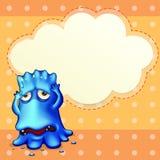 Een blauw monster die onderaan dichtbij het lege wolkenmalplaatje voelen Stock Foto