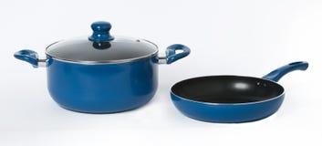 Een blauwe pot en een pan op naadloze witte achtergrond Royalty-vrije Stock Foto's