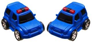 Een blauwe stuk speelgoed bestelwagen van de autopolitie royalty-vrije stock fotografie